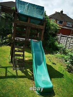 Children's climbing frame with swings in good condition