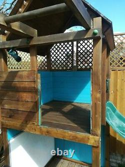 Dunster House Fort plus Escape. Wooden Climbing Frame Playhouse Swings
