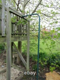 Freestanding timber tree house fort climbing wall fireman's pole slide swings