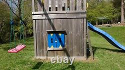 Jungle Gym with Wendy house, swings, slide, sandpit, climbing wal and much more