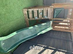 Wooden swing set with slide